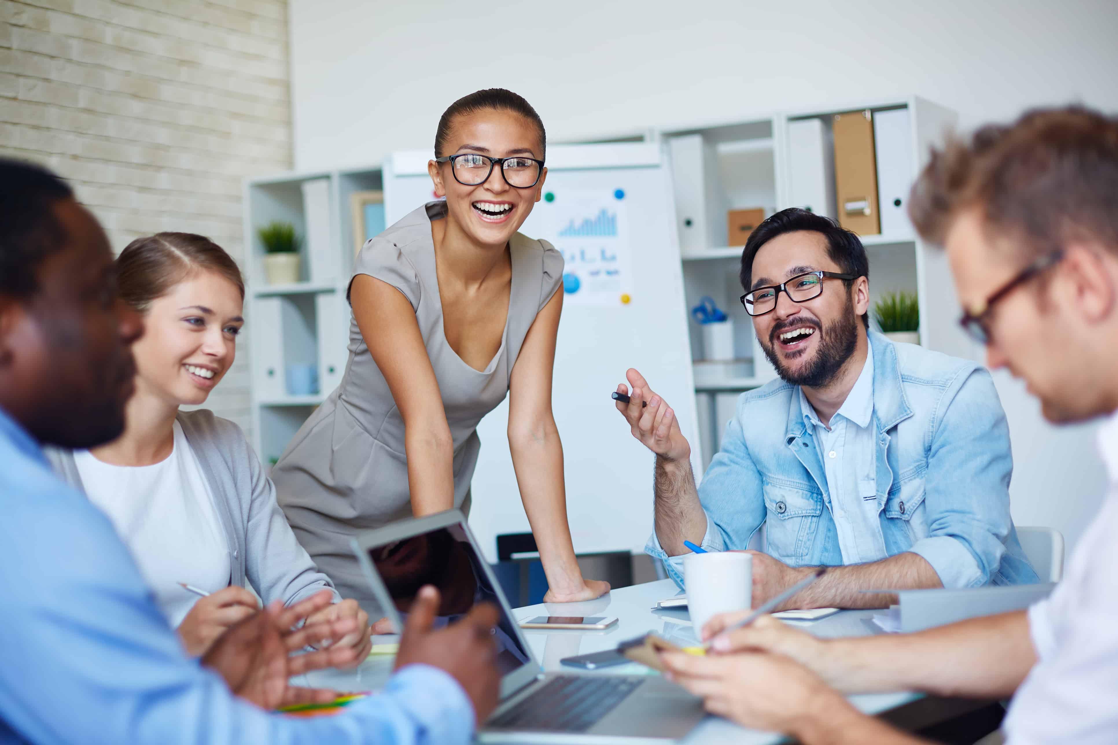 Joyful colleagues planning work at briefing